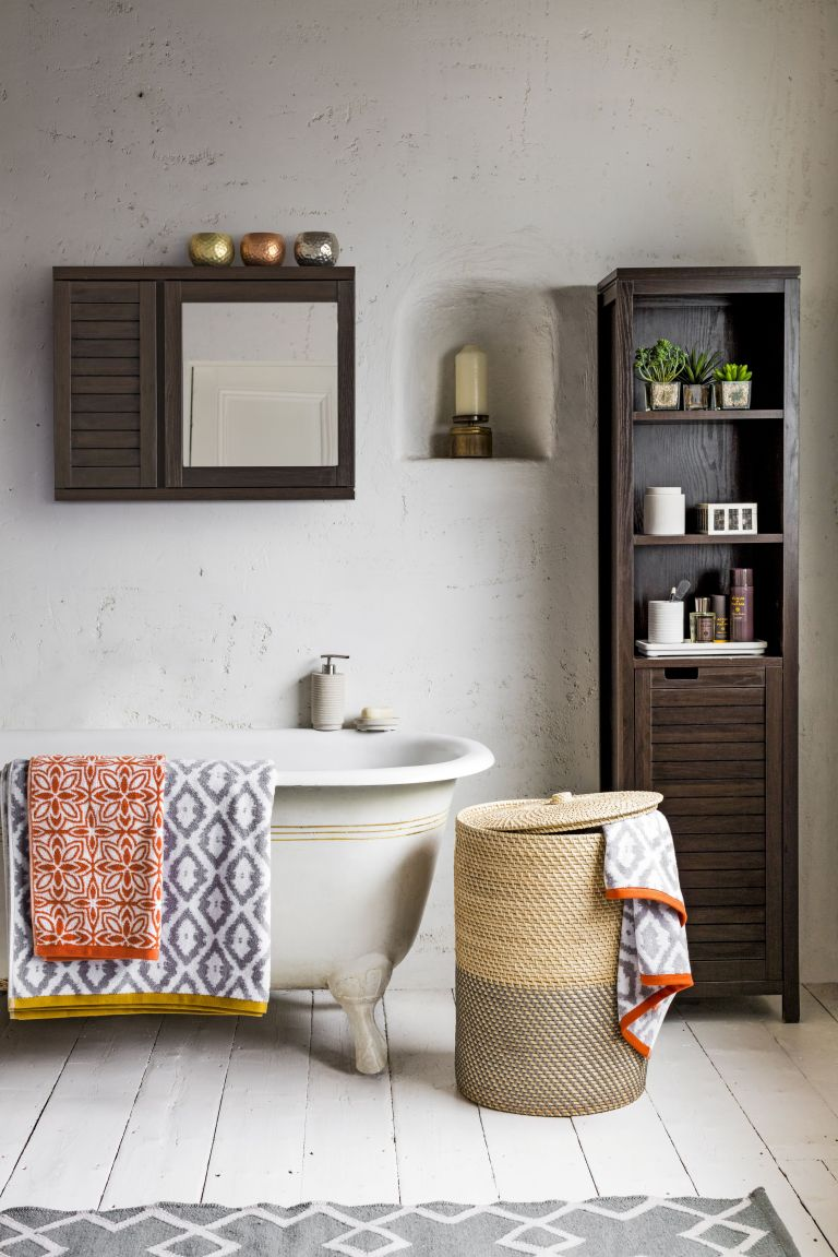 John Lewis bali mirrored double wall cabinet, hammered tealight holder ú7, gold pasiley pillar candle ú10, bali laundry basket ú69, spa mint sandstone  - Copy